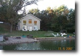 Stunning Raised Ranch on 1 1/2 Lakefront