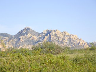 The Dragoon Mountains located in the Coronado National Forest to the east.