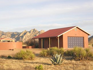 The detached garage with the nearby Dragoon Mountains in the background.