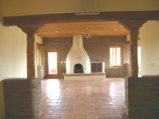 The great room with it's kiva fireplace from the entry.