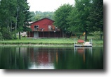 Wisconsin Waterfront 1 Acres Log home on Crystal Clear WI. Lake