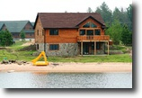 Wisconsin Waterfront 1 Acres Brand New lakefront log home with Beach Fr