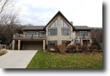 Custom quality home overlooking Lake Wisc.