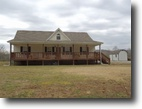 .50 Acres & Home on the River in Clay Co.
