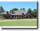 Regal, Custom Built Home on Over 30 Acres