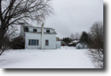 OWNER FINANCING! Home and Barns 70 Acres