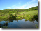 Large Country Acreage with Views & Stream
