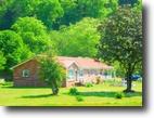 425 Acres 5 Homes, 8 Barns, Ponds, Creek
