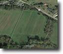 9.5 +/-  Acres  Flat Hay Field