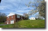 3 BR Brick Home w/Shop on .76 +/- Acres