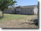 34 acres with 2003 Manufactured Home