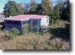 2 Acres & Manufactured Home in Clay Co.