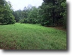 6.895 acres. Wooded w/creek..