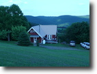 103.2 acre land with cabin and shed