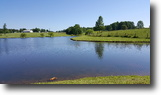 75 beautiful acres with a Lake!