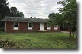 3 BR/2.5 BA Brick Home on .9 +/- Acre Lot
