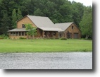 15 acres Log Home near Syracuse NY Pond