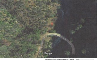 Flatter, secluded camping areas off dirt road along the river, near bridge