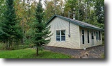 Cabin with 19 acres and pond