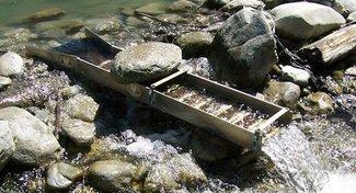 Portable creek powered sluice