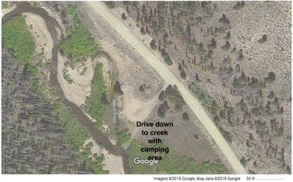 Satellite view close up camping spot by creek