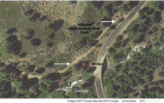 Satellite view of claim side road and creek