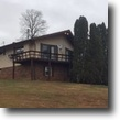 Kentucky Land 3 Acres Chalet style home in Elliott Co, $110,000