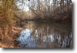 279 Acres of Paradise with River Frontage