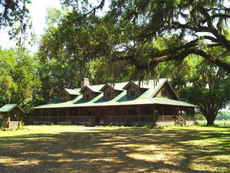 6,000 SF Cypress Log Home on Levy Oaks Ranch