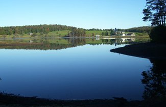 Lot 1 is a 3.15 acre flat property with lake and hay field views.