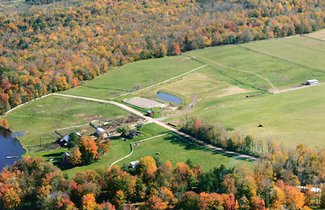 Lot 2 is a 3.1 acre property with lake and hay field views.