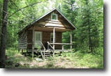 Cabin Bordering State Land 12 Acres