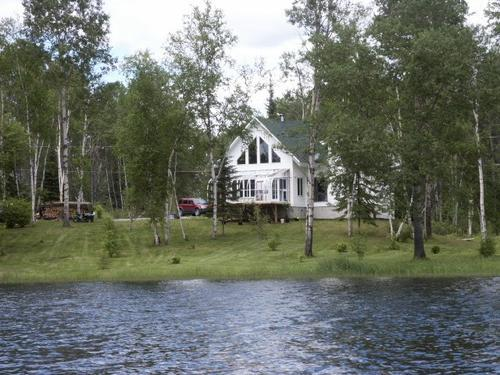 home on sleepy lake down the road quebec