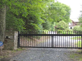 Gated entrance (with remote) to property