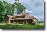 55 +/- Acres Zoned A-1 w/3 BR Custom Home