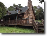 130 Acre Farm with Log Home and Lake