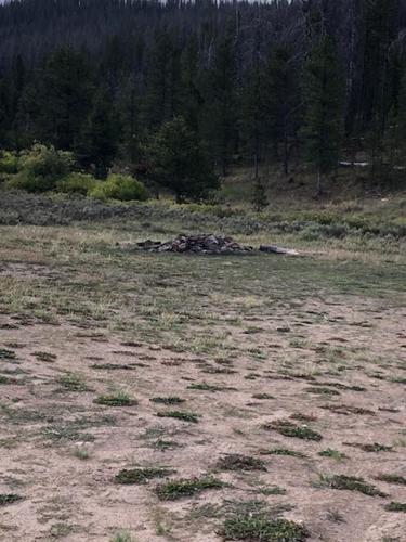 cleared camping spot with fire pit colorado