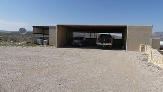Double car carport with storage and generator cover