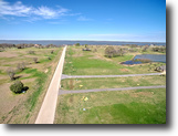 1 acre lake view lot in a gated community