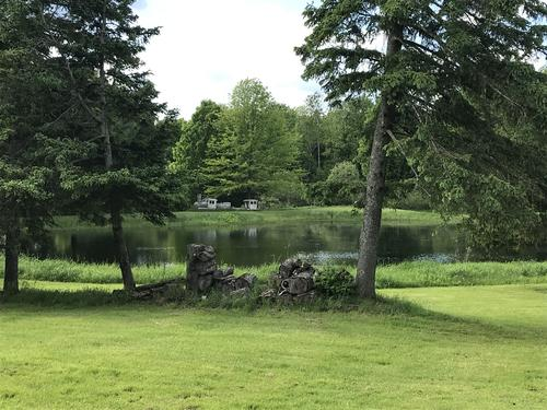 land house with pond in brookfield ny property