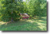 Renovated brick ranch on 15+ acres
