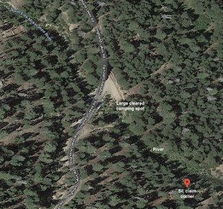 Large cleared camping spot satellite view