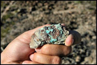 Chrysocolla pocket on claim, used for jewelry