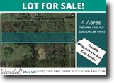 Spectacular 4-Acre Lot in Sand Lake, MI.